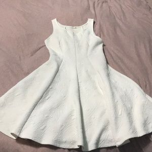 White swirling dress